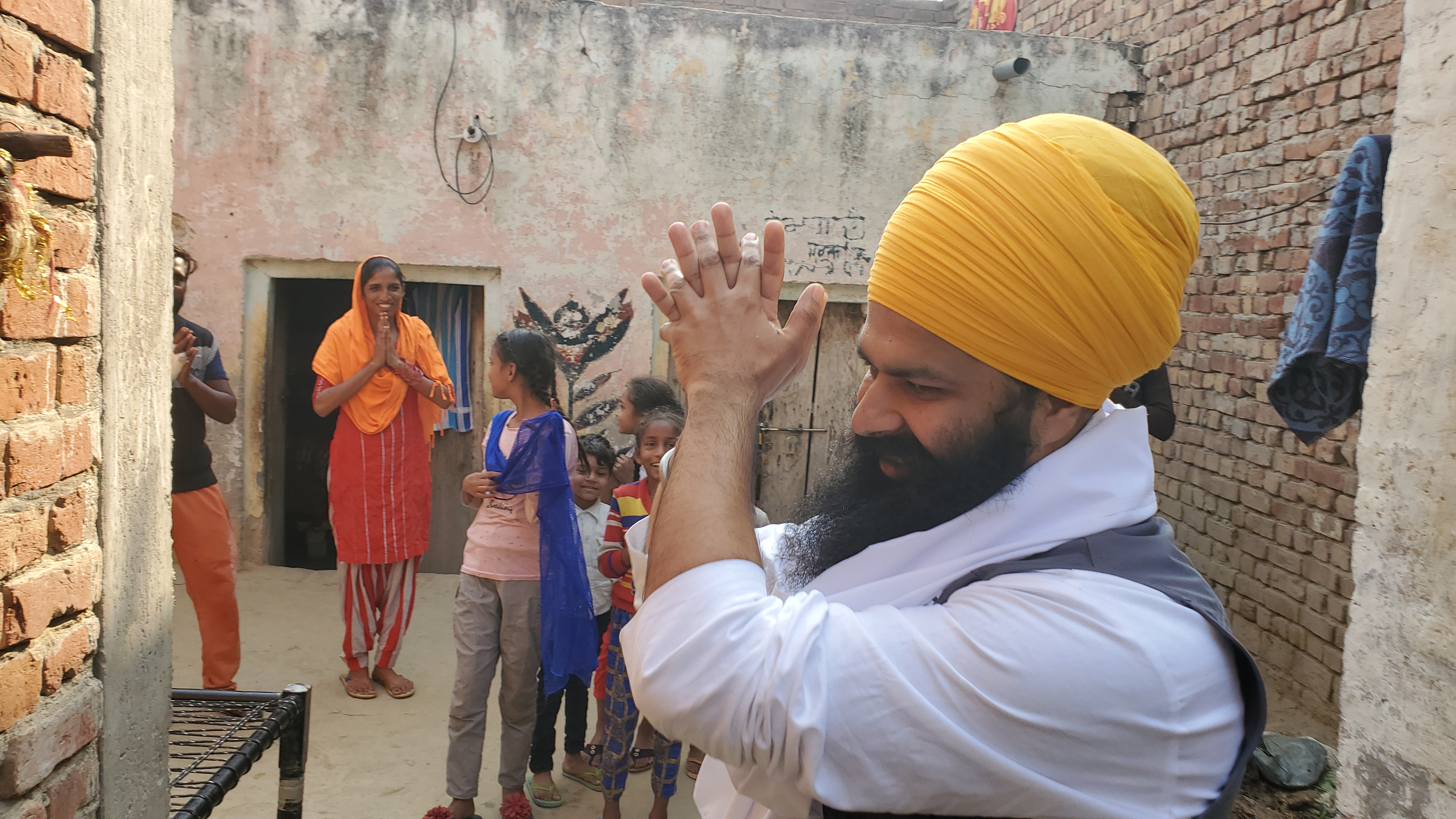 Shamandeep Singh, with a family that the charity has been helping for a while now.